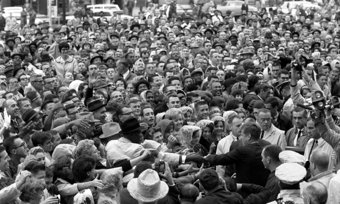 President Kennedy reaches out to the crowd gathered at the Hotel Texas Parking Lot Rally in Fort Worth, TX, 22 November 1963.  (Cecil Stoughton. White House Photographs. John F. Kennedy Presidential Library and Museum, Boston)