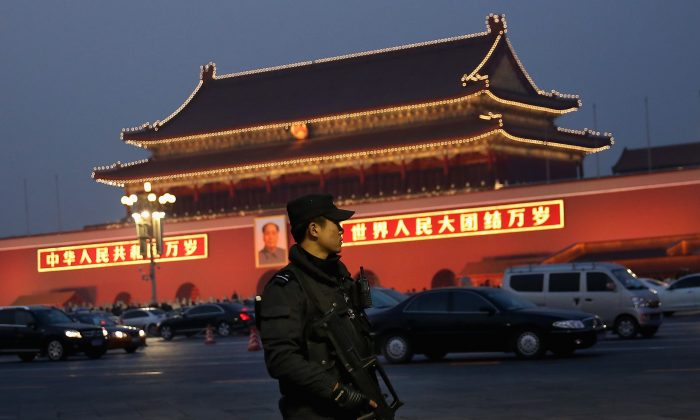 An anti-terror police officer patrols with his gun on Tiananmen Square on Nov. 8, 2013, in Beijing, China, part of the security in place for the Chinese Communist Partys the Third Plenary Session of the 18th Central Committee. At the plenum, which meets from Nov. 9 to 12, significant reforms are expected to be introduced. (Feng Li/Getty Images)