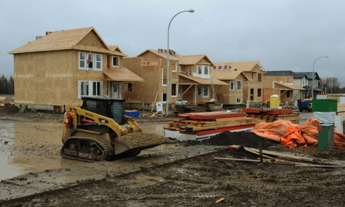 Houses are under construction in a new property development shown in this file photo from 2009 in Fort McMurray, Alberta. Currently, the major centres of Calgary and Edmonton are leading the growth in multi-family units. (Mark Ralson/AFP/Getty Images)