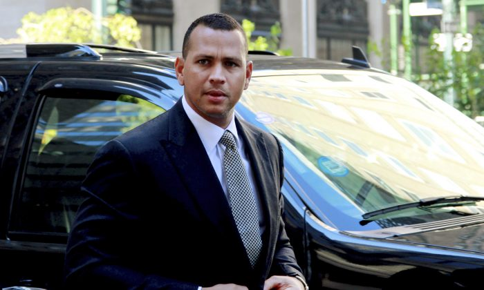 In this Oct. 1, 2013, file photo, New York Yankees' Alex Rodriguez arrives at the offices of Major League Baseball in New York, for his grievance hearing. (AP Photo/David Karp, File)