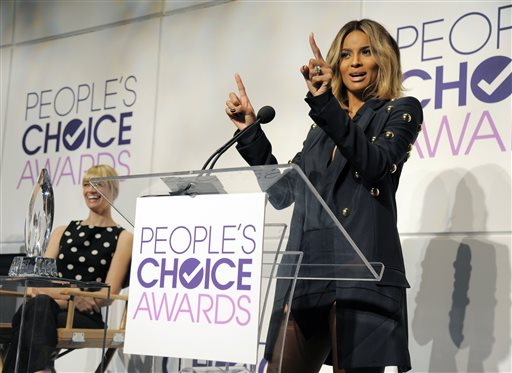Singer Ciara, right, announces nominations for the 40th Annual People's Choice Awards at The Paley Center for Media on Tuesday, Nov. 5, 2013 in Beverly Hills, Calif. Looking on at left is fellow presenter Beth Behrs. The show will be held on Jan. 8, 2014 at the Nokia Theater L.A. Live in Los Angeles. (Photo by Chris Pizzello/Invision/AP)