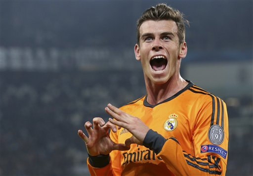 Real's Gareth Bale celebrates after scoring during a Champions League, Group B, soccer match between Juventus and Real Madrid at the Juventus stadium in Turin, Italy, Tuesday, Nov. 5, 2013. (AP Photo/Antonio Calanni)