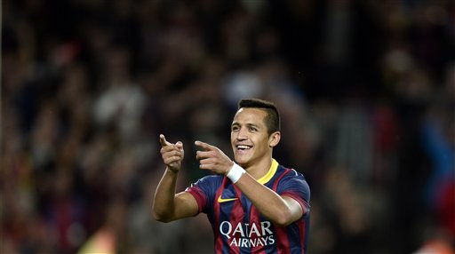 FC Barcelona's Alexis Sanchez, from Chile, reacts after scoring against Espanyol during a Spanish La Liga soccer match at the Camp Nou stadium in Barcelona, Spain, Friday, Nov. 1, 2013. (AP Photo/Manu Fernandez)