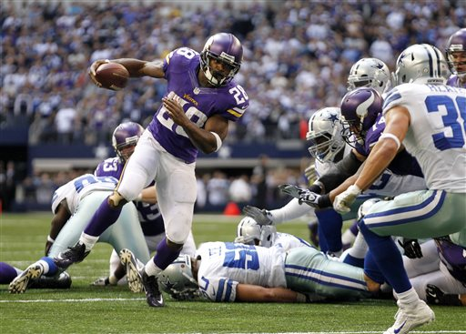 Minnesota Vikings' Adrian Peterson (28) breaks away from tackles as he heads for the end zone on a touchdown run during the second half of an NFL football game against the Dallas Cowboys, Sunday, Nov. 3, 2013, in Arlington, Texas. (AP Photo/Tim Sharp)