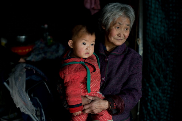A photo taken on March 21, 2013 shows a woman with one of her grandchildren in their home in Chengde, Hebei province, a town where inhabitants are not bound by the 'one-child' birth-control policy enforced in other parts of China. China's coercive one-child policy was discussed at this week's high-level Party meeting. (Ed Jones/AFP/Getty Images)