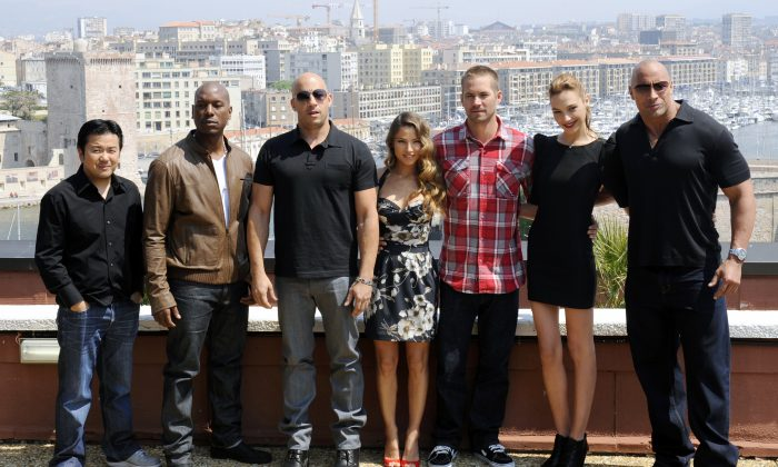 The cast of the movie 'Fast and Furious 5' (from left) director and producer Justin Lin, US actors Tyrese Gibson and Vin Diesel, Spanish actress Elsa Pataky, US actor Paul Walker, Israeli actress Gal Gadot and US actor Dwayne Johnson pose on April 28, 2011 in Marseille. (Boris Horvat/AFP/Getty Images)