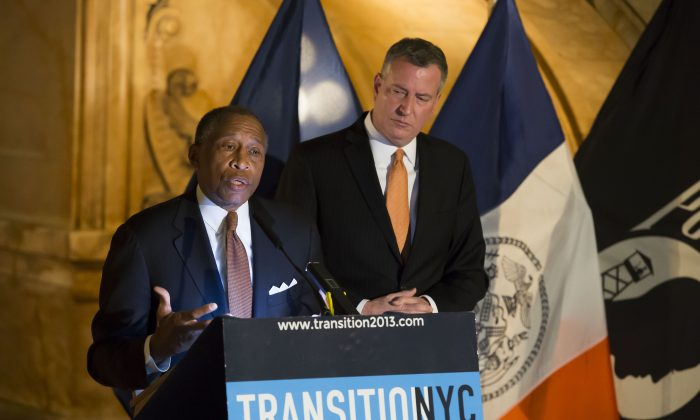 Zachary Carter (L), the city's new corporation counsel, speaks alongside Mayor-elect Bill de Blasio, at the Surrogate's Courthouse in Lower Manhattan, New York, Dec. 29, 2013. (Rob Bennett for the de Blasio Transition Committee)