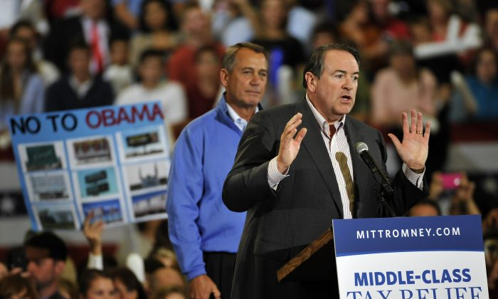 Former governor of Arkansas Mike Huckabee (R) speaks as U.S. Speaker of the House (L) John Boehner (R-OH) looks on during a campaign rally for Republican presidential candidate, former Massachusetts Gov. Mitt Romney on October 11, 2012 in Asheville, North Carolina. (Rainier Ehrhardt/Getty Images)