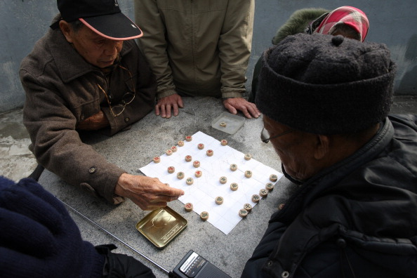 Old men playing chess in China. A suicide victim in Zhejiang Province is reported to have killed his neighbor so that they could play chess together in the afterlife. (Godong/Universal Images Group via Getty Images)