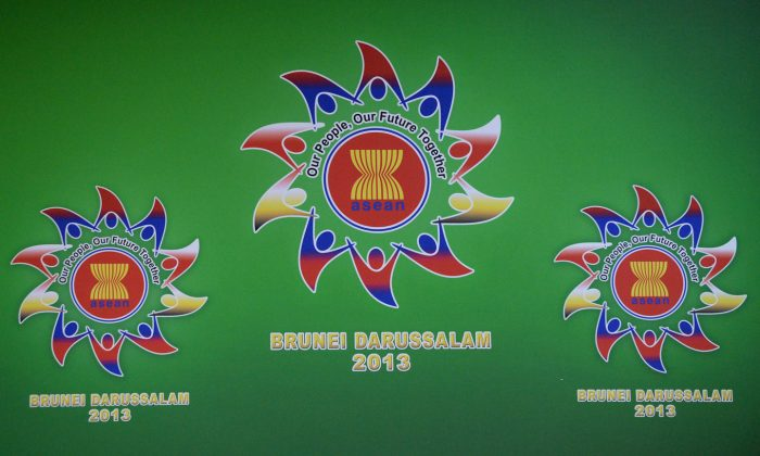 A picture shows logos for the 46th ASEAN Foreign Ministers Meeting in Bandar Seri Begawan on June 29, 2013. India is increasingly engaging with ASEAN to counter China's influence in south east Asia. (Roslan Rahman/AFP/Getty Images)