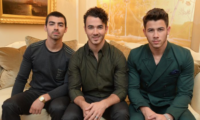 (L-R) Joe Jonas, Kevin Jonas, and Nick Jonas of the Jonas Brothers at the Mercedes-Benz Fashion Week Spring 2014 at Lincoln Center in September. (Mike Coppola/Getty Images for Mercedes-Benz)