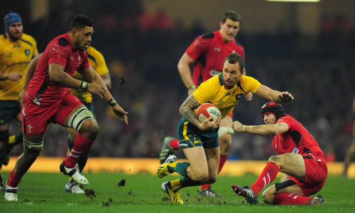 Quade Cooper of the Australia Wallabies spots a gap and leaves Leigh Halfpenny of Wales grasping at thin air during their match at Millennium Stadium in Cardiff on Nov 30, 2013. (Stu Forster/Getty Images)