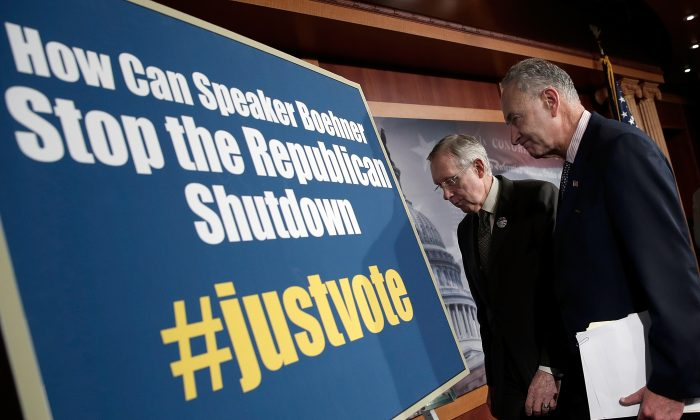 GOVERNMENT SHUTDOWN, DAY 4: Senate Majority Leader Harry Reid (D-Nev.) (L) and Sen. Charles Schumer (D-N.Y.) (R) leave a press conference on the government shutdown Oct. 4, in Washington, D.C. (Win McNamee/Getty Images)