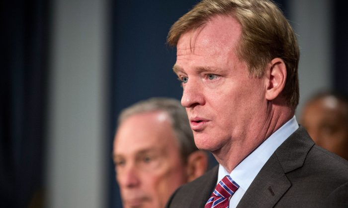 NFL Commissioner Roger Goodell (R) speaks at a press conference held by New York Mayor Michael Bloomberg, regarding Super Bowl XLVIII, on Oct. 10 in New York City. The NFL's tax-exempt status is being challenged by politicians and activists.  (Andrew Burton/Getty Images)