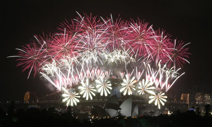 Fireworks explode over the Harbour Bridge and the Opera House during New Year's Eve celebrations in Sydney, Australia, Wednesday, Jan. 1, 2014. (AP Photo/Rob Griffith)