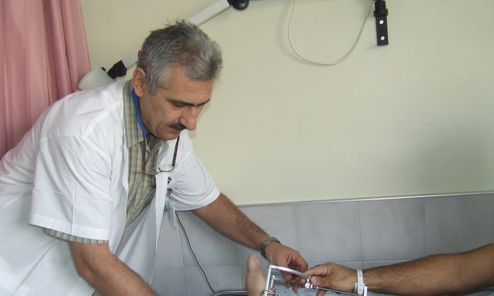 Dr. Alexander Lerner treats a patient at the Ziv Medical Center in Safed, Israel, near the Syrian border. Many Syrian patients raised to see Israelis as enemies discover they can also be friends. (Courtesy of Ziv Medical Center)