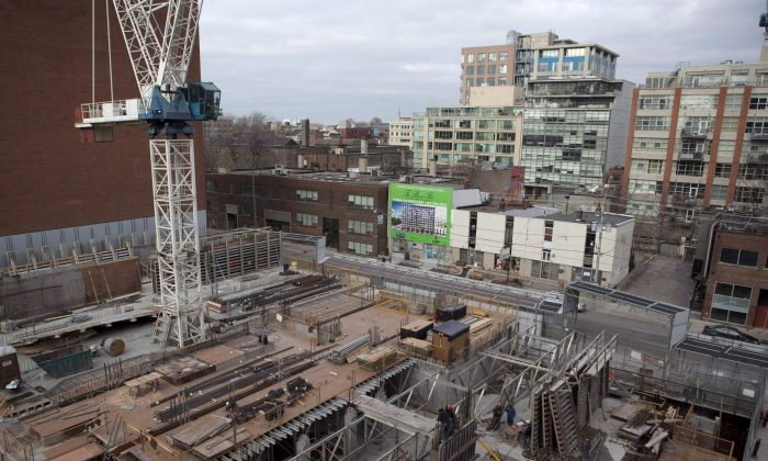 A condominium under construction is shown in Toronto in this February 2012 file photo. Major housing markets diverged in November 2013 with a Greater Toronto Area sales decrease offsetting an increase in sales in Vancouver. (The Canadian Press/Pawel Dwulit)