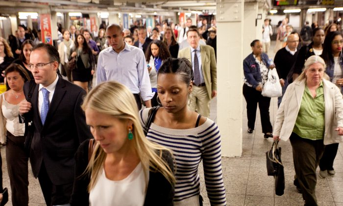 Subway passengers at Times Square on Sept. 24, 2012. (Epoch Times)