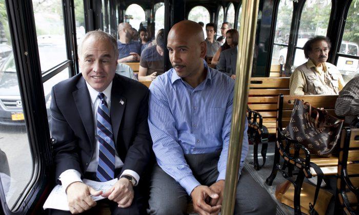Ruben Diaz Jr., Bronx borough president (R), rides on a bus during a tour of the Bronx, New York, on July 11, 2013. (Samira Bouaou/Epoch Times)