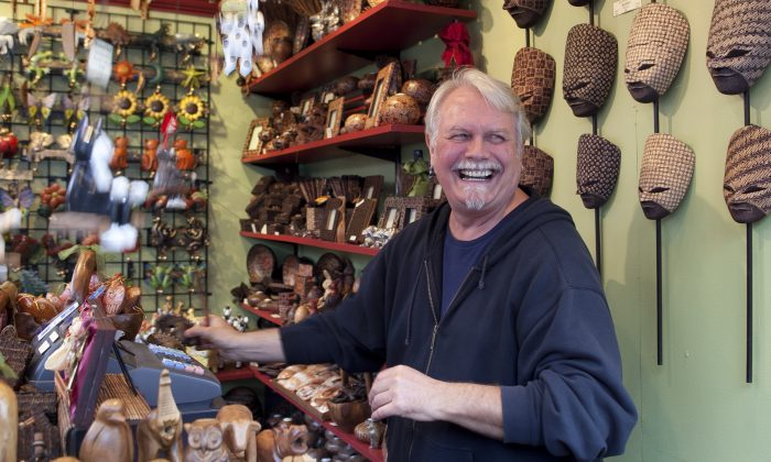 Claus von Ronnex-Printz sells Indonesian crafts at his booth, Bali Made, in Union Square on Dec. 5. (Samira Bouaou/Epoch Times)
