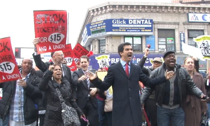 New York City Council member Ydanis Rodriguez joins protesters outside a McDonald's on 181st Street, calling for higher wages, in New York, Dec. 5, 2013. (Seth Hirsch)