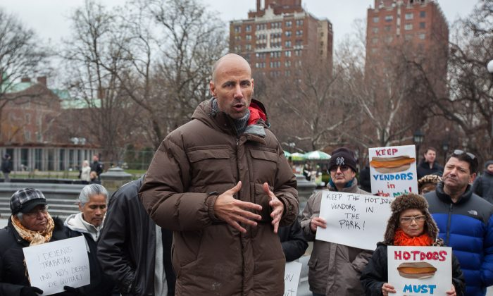 Sean Basinski, director of the Street Vendor Project, speaks at a rally in Washington Square Park in Manhattan, New York, on Dec. 8, 2013. (Petr Svab/Epoch Times)