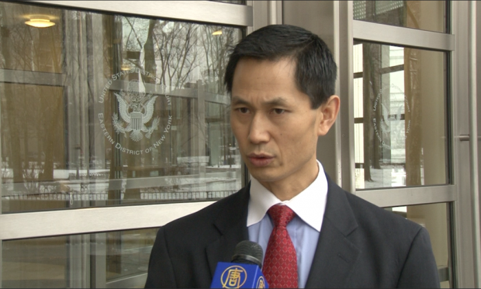 Defense attorney Chen Mingli Chen speaks to media outside the U.S. District Court for the Eastern District of New York on Dec. 10, 2013. (NTD Television)