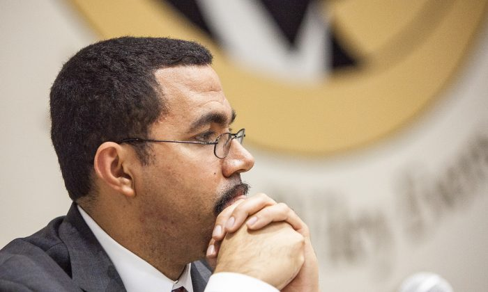 State Commissioner of Education, John King Jr., listens to remarks of the public at a community forum at the Medgar Evers College, Brooklyn, New York, Dec. 10, 2013. (Petr Svab/Epoch Times)