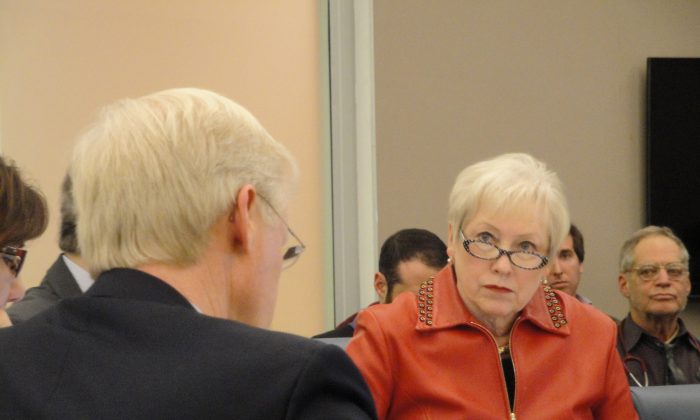 State University of New York (SUNY) chancellor Nancy Zimpher listens to SUNY trustee John Murad speak at a board meeting in Manhattan on Dec. 17, 2013. (Sarah Matheson/Epoch Times)