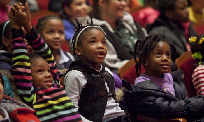 Kids watch the Taste of Broadway show at the Salvation Army Centennial Theatre, Midtown Manhattan, New York, on Dec. 17, 2013. (Samira Bouaou/ Epoch Times)
