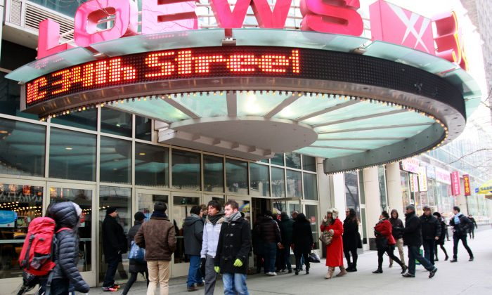 People crowd at an entry to the AMC Loews movie theater on 34th Street in Manhattan Wednesday. (Ivan Pentchoukov/Epoch Times)