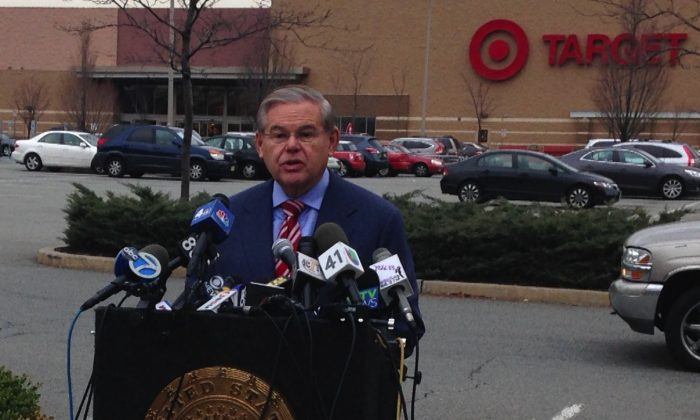 New Jersey Senator Robert Menendez announced that he sent a letter to the FTC regarding the Target data breach in front of a Target store in Newport, Jersey City, December 26, 2013 (Yi Yang).