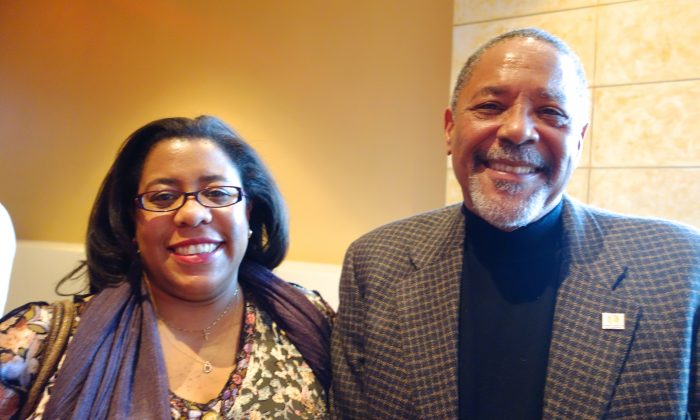 Mr. Clary Washington and his daughter Ms. Stacy Washington at a Shen Yun matinee Cobb Energy Centre in Atlanta, Dec. 28, 2013. (Mary Silver/Epoch Times)