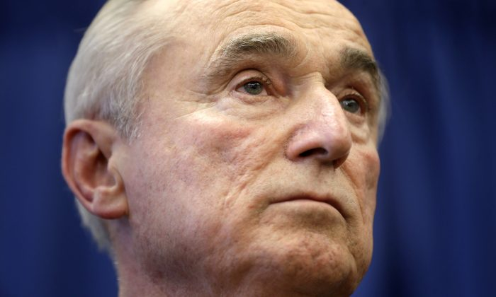 William Bratton listens during a news conference in New York, Thursday, Dec. 5, 2013. (AP Photo/Seth Wenig)