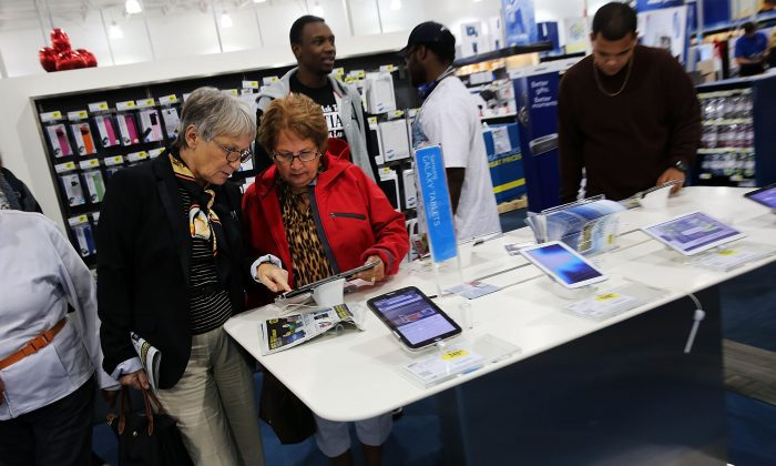 Two women shop for iPads at a Best Buy store on Nov. 29 in Naples, Fla. Despite their earning power, baby boomers are overlooked in business marketing plans. (Photo by Spencer Platt/Getty Images)
