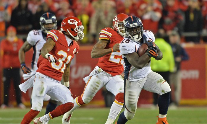 Running back Montee Ball #28 of the Denver Broncos rushes up field for a first down past defenders Marcus Cooper #31 and Kendrick Lewis #23 of the Kansas City Chiefs during the second half on December 1, 2013 at Arrowhead Stadium in Kansas City, Missouri.  Denver beat Kansas City 35-28.  (Photo by Peter Aiken/Getty Images)