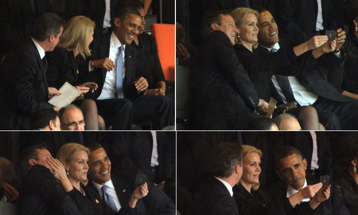 This combo of pictures shows US President Barack Obama (R) and British Prime Minister David Cameron (L) posing for a selfie photo with Denmark's Prime Minister Helle Thorning Schmidt (C) during the memorial service of South African former president Nelson Mandela at the FNB Stadium (Soccer City) in Johannesburg on December 10, 2013. Mandela, the revered icon of the anti-apartheid struggle in South Africa and one of the towering political figures of the 20th century, died in Johannesburg on December 5 at age 95. (Roberto Schmidt/AFP/Getty Images)