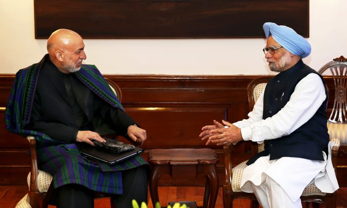 Indian Prime Minister Manmohan Singh (R) talks to Afghan President Hamid Karzai at his residence in New Delhi on December 13, 2013. Karzai was on a four-day official visit to India until December 15. India has promised more defense and security cooperation to Afghanistan. (Saurabh Das/AFP/Getty Images)