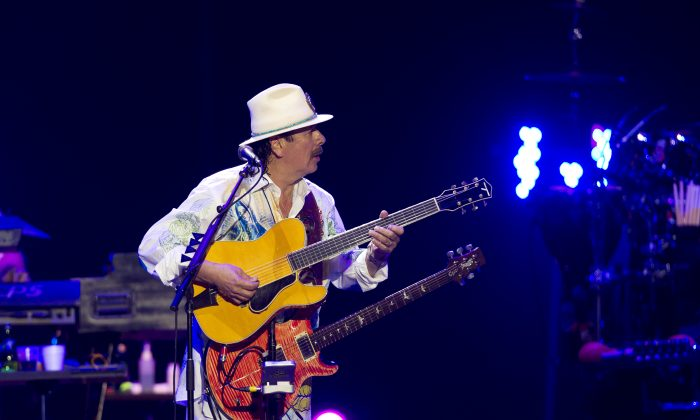 US-Mexican musician Carlos Santana performs during the Santana and Special Guests concert in Guadalajara on December 14, 2013. AFP PHOTO/Hector Guerrero (Photo credit should read HECTOR GUERRERO/AFP/Getty Images)