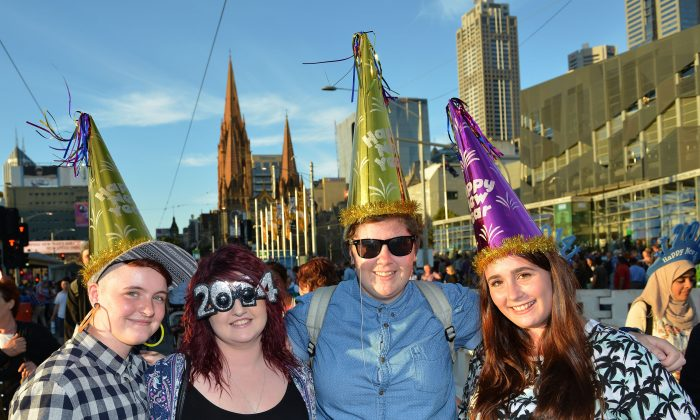 People celebrate New Year's Eve on December 31, 2013 in Melbourne, Australia. (Vince Caligiuri/Getty Images)