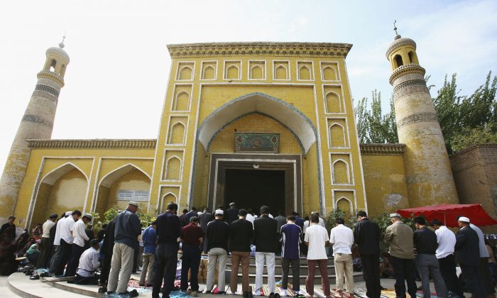 Muslims pray outside a mosque on September 22, 2006 in Kashi of Xinjiang Uygur Autonomous Region, northwest China. Kashi is an oasis city which has been noted in ancient times along the old silk road as a political and commercial centre. It is the hub of an important commercial district, bordering Russia, Afghanistan, Kazakhstan, Tajikistan, Kyrgyzstan and Uzbekistan with Pakistan to its south. The Islamic Uygur ethnic minority group constitutes the majority of its population. (China Photos/Getty Images)