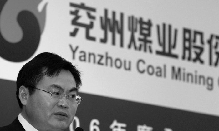 Chinese mining company Yanzhou will now be able to have 100 per cent control over Australian coal company Yancoal, which operates 10 mines across several states, after Federal Treasurer Joe Hockey removed foreign ownership conditions that prevented the move. (Philippe Lopez/AFP/Getty Images)