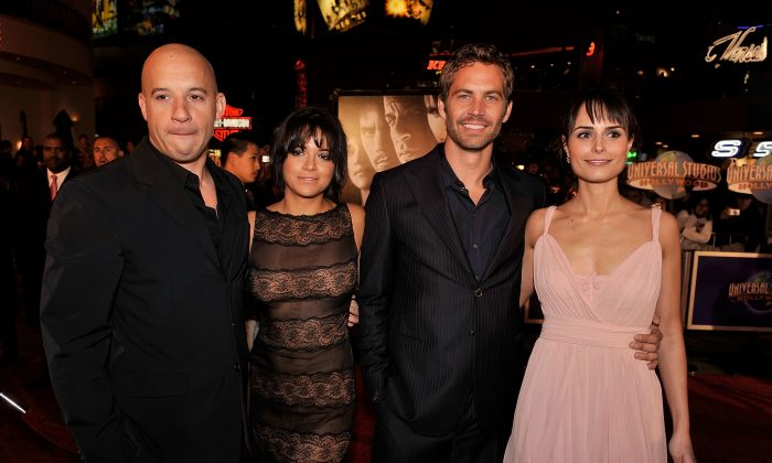Michelle Rodriguez paid tribute to Paul Walker following Walker's death. Here, Vin Diesel, Rodriguez, Walker, and Jordana Brewster in a file photo. (Kevin Winter/Getty Images)