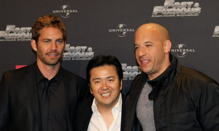 (L-R) Paul Walker, director Justin Lin, and Vin Diesel arrive for the Europe premiere of Fast & Furious on March 17, 2009 in Bochum, Germany.  (Ralph Orlowski/Getty Images)