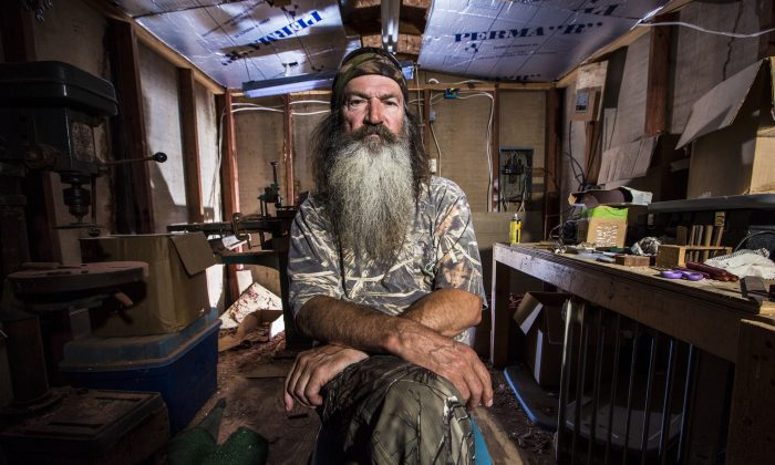 """This undated image released by A&E shows Phil Robertson from the popular series """"Duck Dynasty."""" Robertson was suspended for disparaging comments he made to GQ magazine about gay people but was reinstated by the network on Friday, Dec. 27. In a statement Friday, A&E said it decided to bring Robertson back to the reality series after discussions with the Robertson family and """"numerous advocacy groups."""" (AP Photo/A&E,)"""