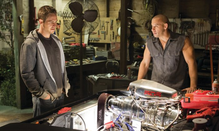 An undated screenshot of Paul Walker and Vin Diesel (R) from the movie Fast & Furious 7. (AP Photo/Universal Pictures, Jaimie Trueblood)