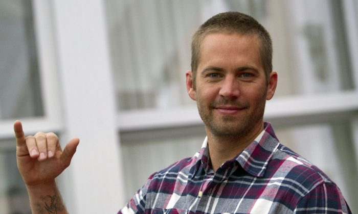 "Actor Paul Walker poses during the photo call of the movie ""Fast and Furious 5"", in Rome Friday, April 29, 2011. (AP Photo/Andrew Medichini)"