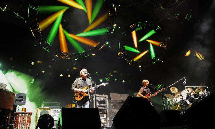 Phish band members Trey Anastasio, Mike Gordon, and Jon Fishman, from left, performs during their benefit concert at the Champlain Valley Exposition in Essex Junction, Vt, on Wednesday, Sept. 14, 2011. (AP Photo/Alison Redlich)