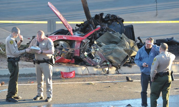 The wreckage of a Porsche that Paul Walker was a passenger in, in Valencia, Calif., on Saturday, Nov. 30, 2013. (AP Photo/The Santa Clarita Valley Signal, Dan Watson)
