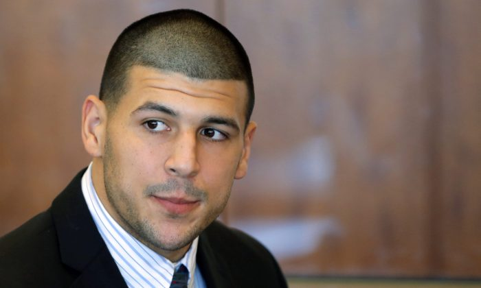 In this Oct. 9, 2013 file photo, former New England Patriots NFL football player Aaron Hernandez attends a pretrial court hearing in superior court in Fall River, Mass. Tabitha Perry, who has ties to Hernandez, died on December 16, about a half a year after she survived a car crash that killed Thaddeus Singleton III, who also had ties to Hernandez. (AP Photo/Brian Snyder, Pool, File)